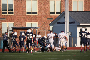 Football players run to tackle the other team to prevent them from scoring. Photo by Sammi Beeler