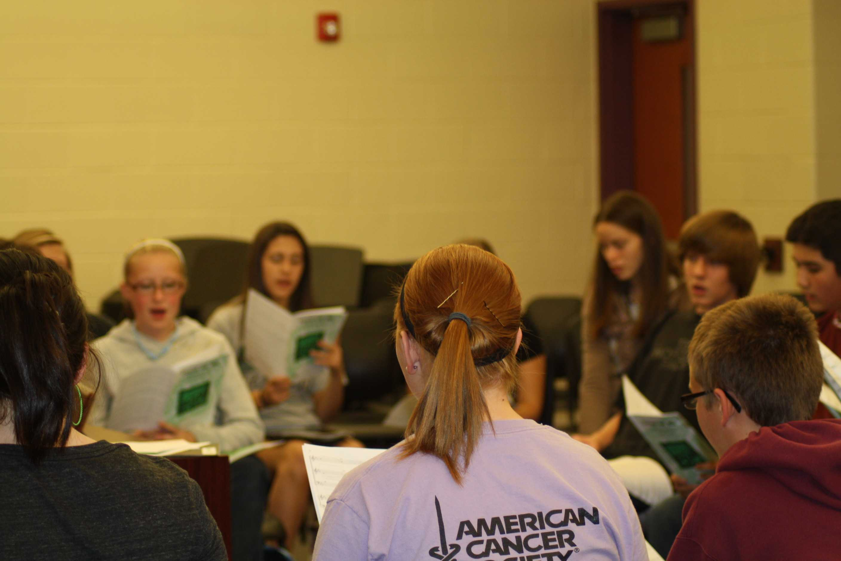 Vocal ensemble practices their music for all city chorus concert, during their third practice.