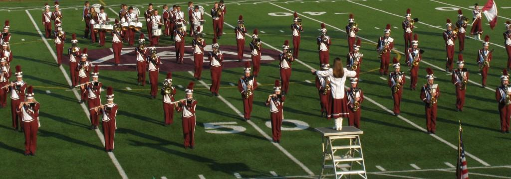 Are you sure that isn't a college band?  The AAJHS Varsity Band performs the National Anthem in