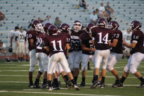 Altoona's offense lines up in the huddle to get the play.  Altoona ran many different plays against State College.