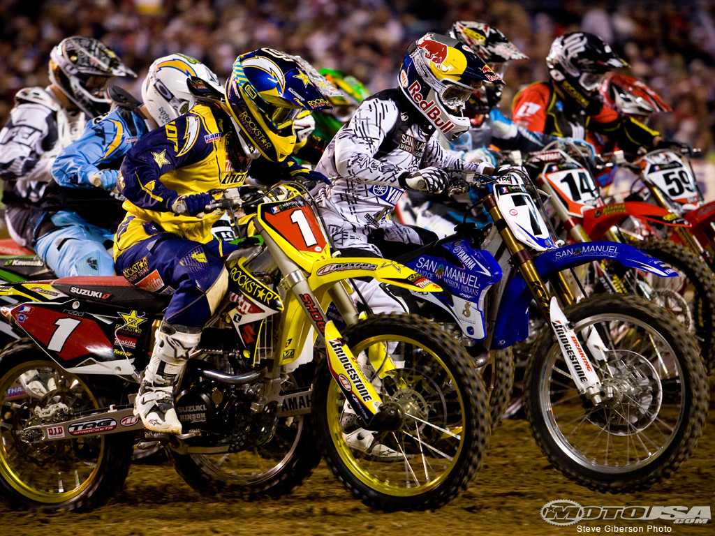 Multiple riders head for hole shot in there first race in San Diego, California. Photo courtesy of