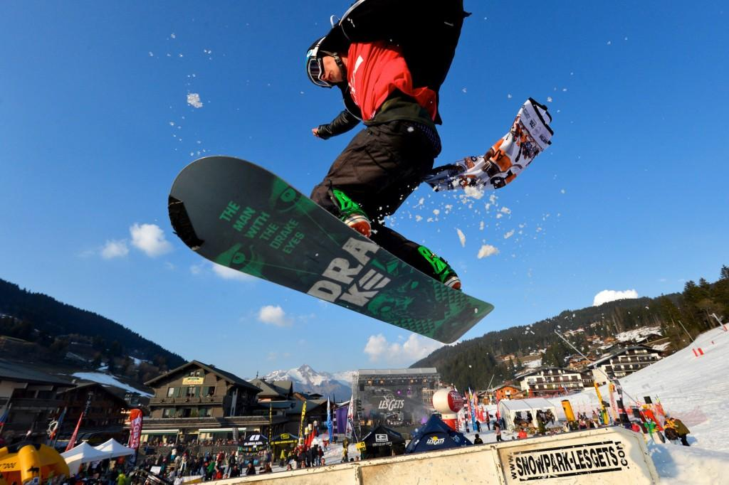 This+is+a+picture+of+someone+snowboarding+in+front+a+crowd+doing+a+trick.++Photo+courtesy+of+Jean-Micheal+Baud