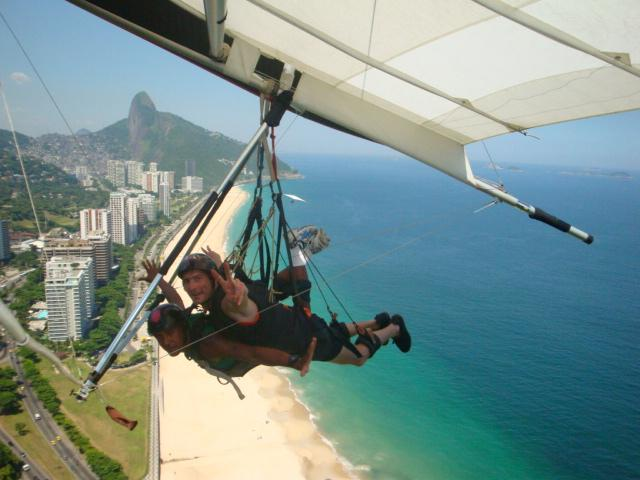 A young man glides over the Rio de janeiro with his instructor. photo credit: flickr.com photo by: reeform system