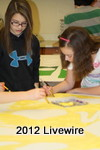 During the Community Inspired Arts program, Sarah Socie and her friend Meghann Mignogna work on a mural for the school.