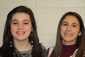 Morgan Hinish and Sylvia Lombardo posed together for a picture.  The two are in vocal ensemble.  Photo by Arian Savoy.
