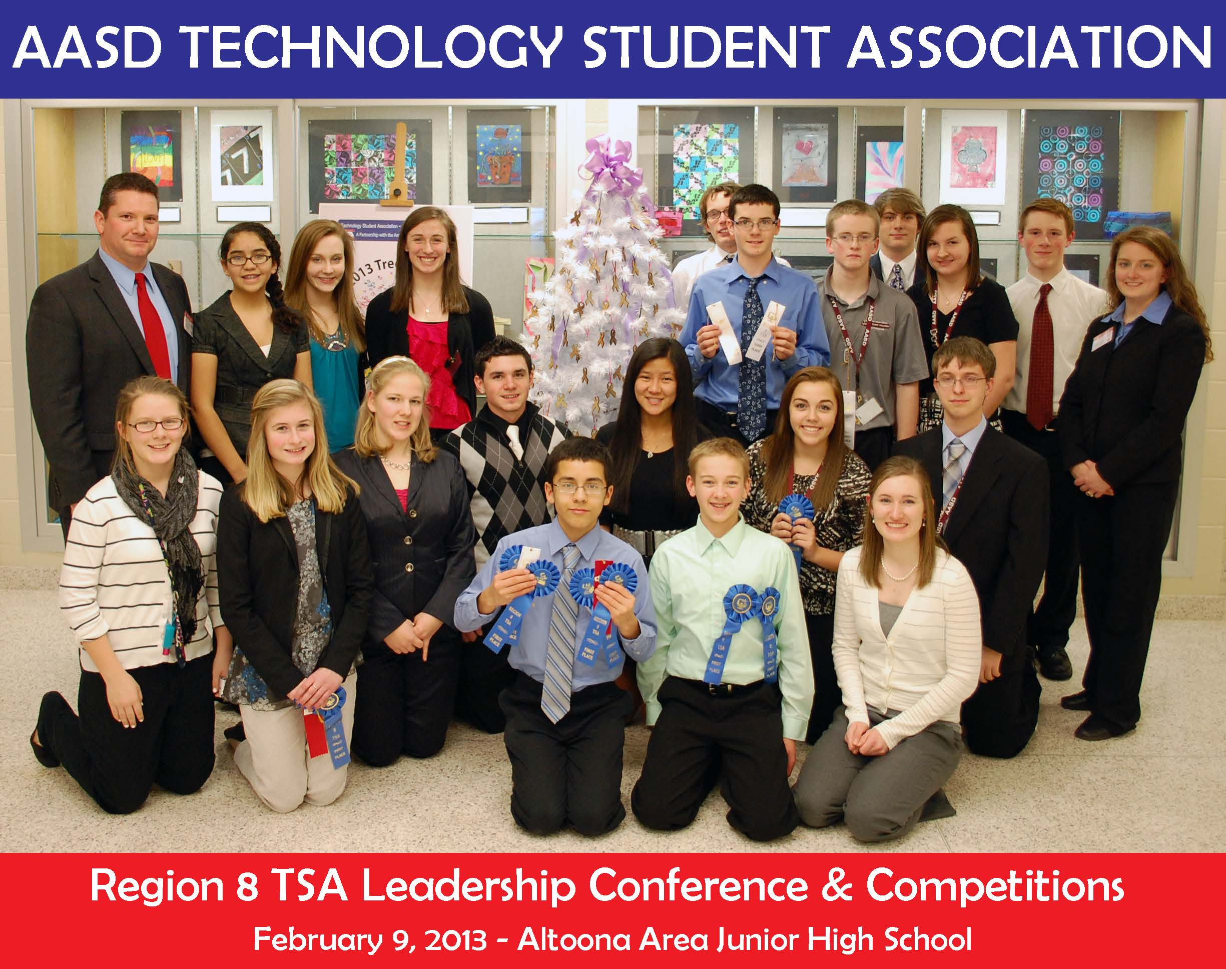 The Technology Student Association(TSA) from junior high and high school levels gather for a group picture after their regional competition held at the junior high.