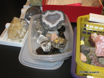 The students visit Mrs. Mackereth's desk to get the rocks and minerals they need for the science experiment.