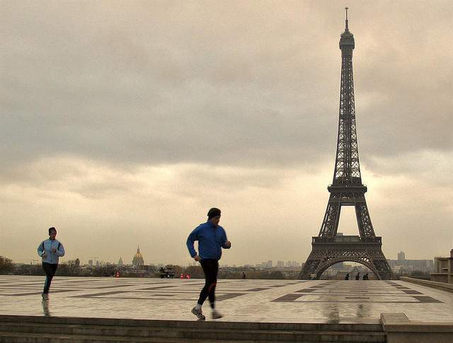 On a rainy day in Paris, the Eiffel Tower still is a popular attraction.
