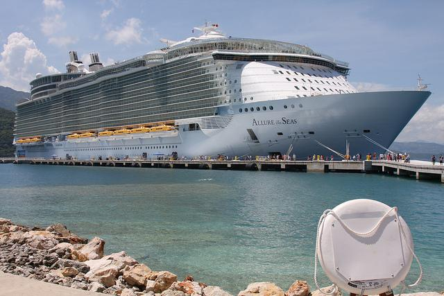 The Allure of the Sea sits at port while people board for their cruise.
