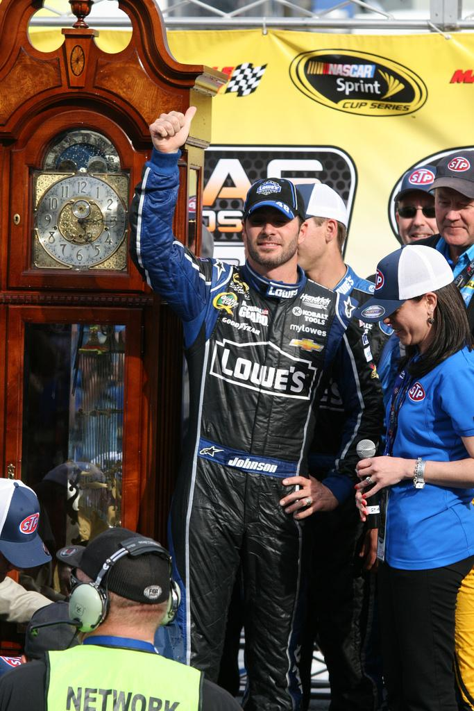 Jimmie Johnson receiving his eighth Grandfather Clock. Photo courtesy of PDA.PHOTO