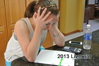 Seventh grader Shelby McCloskey feels stressed out over her homework at her home.  Stress can affect the quality of student's homework by not allowing them to concentrate.  Photo taken by Tyler McCloskey.