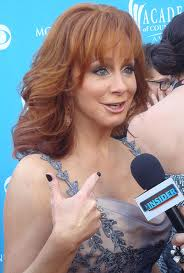 Reba McEntire is getting interviewed. Courtesy of http://commons.wikimedia.org/wiki/File:RebaMcEntireApr10.jpg
