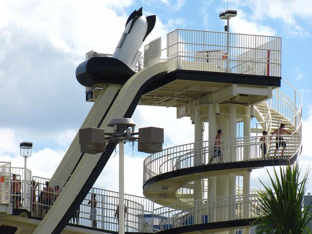 Gentlemen climb the steps to the Bomb Bay slide.