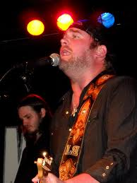 Lee Brice singing to his fans. Courtesy of http://www.flickr.com/photos/denisemattox/4625212903/