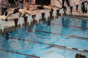 Indoor swim brings home win and loss