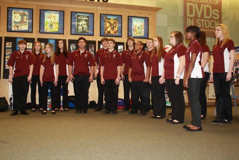 Deck the Halls! Vocal Ensemble performs at the Barnes and Noble Book Fair. After the Vocal Ensemble performed, the Chamber and Orchestra performed. Photo by Hannah Barr