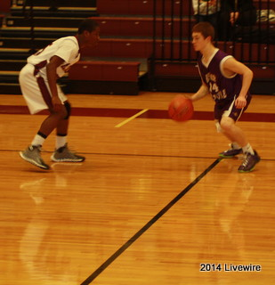 Ninth grader, Steve Franklin, plays defense. He was defending the ball so that the opposing team did not score.  Photo by Hanna Feathers