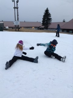 Sydney Starbird and Kristin Wineland play in the snow at Blue Knob Ski Resort. They are playing around in the snow before they get ready to ski. Photo by Becca Gallace