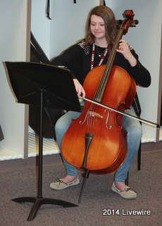 "Ninth grader, Sarah Schmitt, practices her cello during class. She was practicing a piece of music called ""Fantasia on a Theme from Thailand."" This music is for the Chamber Orchestra Concert. Photo By: Hanna Feathers"