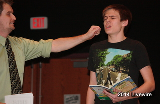 Ninth grade teacher and play director, Johnathan Klingeman, and ninth grader, Michael Bruce practice for the upcoming play, Peter Pan Jr. Bruce was portraying the part of Captain Hook. The cast practice almost everyday so that they can memorize their lines and songs. Photo By: Hanna Feathers