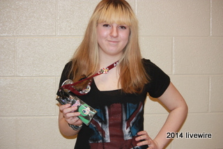 Ninth grade student Kyra Bailey sports a picture of anime character Hatsune Miku  on her lanyard. Bailey did this to honor the first club meeting. Photo by- Joanne Pringle