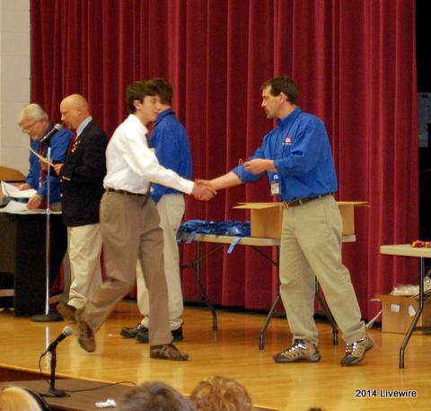 Ninth grader, Tyler Rispoli, accepts his award during the ceremony. Photo by Tim Dzurko