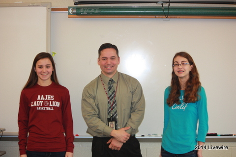 Working Students!  Two students, Maura Skelley and Andrea Scott, with their teacher Andrew Danish in American Culture.  These were the winners of the writing contest he entered them in.