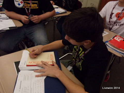 Good Work!  William Ajay is getting his notebook out so that he get his work done.  He also was being prepared and had his Spanish notebook out.  Photo by Jacob Hord
