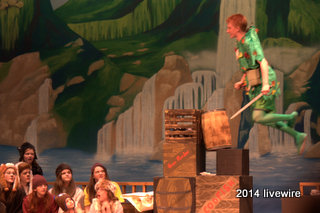 Ninth grader Trent Miller flies over the stage during one of the final scenes of the play. Miller played the role of Peter Pan. Photo by- Joanne Pringle