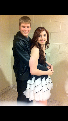 Smile! Abigail Randolph and her date, Lance Langensiepen take a picture in their dance clothes. Picture courtesy of Abigail Randolph.