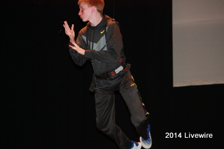 Trent Miller is learning how to fly for the school play Peter Pan. This is their first flying practice and its going to take some getting used to. Photo by Becca Gallace