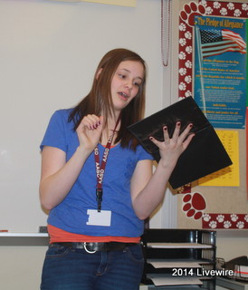Ninth grader, Taylor Berardi practices her speech for the upcoming performance at Barnes and Nobel next Tuesday.  She was practicing her new story that she just got at the meeting. Her story was about Romeo and Juliet. Photo by Hanna Feathers
