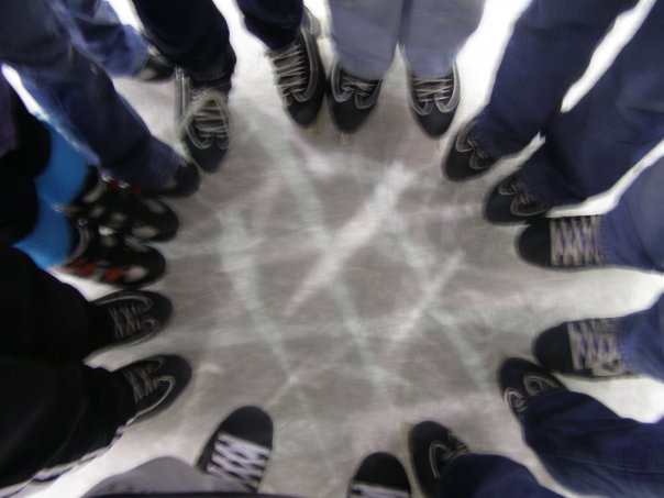 A+group+of+friends+come+together+in+the+middle+of+an+ice+rink.+They+join+hands+and+put+their+feet+together+in+order+to+display+their+%22circle+of+friends%22.