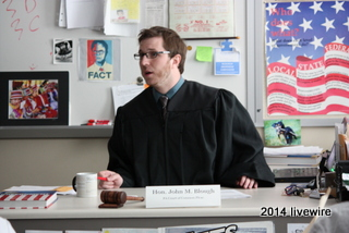 Mr. John Blough plays the role of the judge in his mock trial. Blough wore an old, black graduation gown to help get into character. Photo by Joanne Pringle