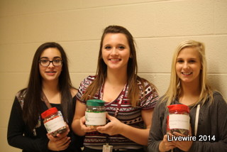 In this photograph is member of the ninth grade committee, Halle Miller, Shianne Graham, and Madisyn McMulin.