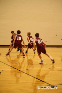 seventh grades boys on the basketball team work hard for their game photo taken by Emily Simmons