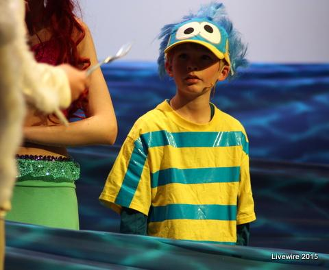 Ethan Katcher who played flounder was swimming through the sea with Ariel   Photo taken by Emily Simmons