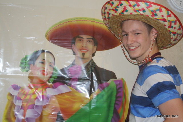 Ninth+grader+Tyler+Barry+poses+with+a+Spanish+poster+during+the+Cinco+De+Mayo+celebration+period.++Photo+by+Sarah+Harmon.
