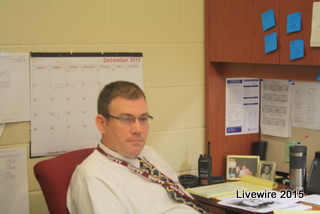 Mr. Robison at his at desk in the seventh grade office.  Picture by Mikey Baker.