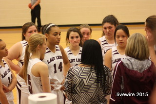 The ninth grade girls' basketball team huddles in their game against BG.  Photo by: Baylie Horten