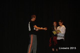 Nathan Wright reads his lines during practice.  Wright is playing the Hun leader for the musical.  Photo by Michael Baker