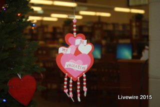 Near the main lobby, the school library puts Valentine's day decorations in their windows to celebrate this upcoming holiday.  Another thing that is helping students celebrate this special day is the Sweethearts dance.