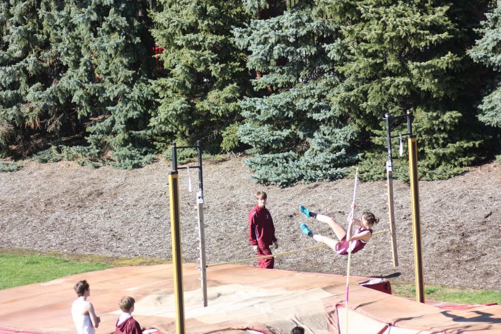 Ninth+grader+Julia+Gonsman+makes+her+way+over+the+6%27+pole+vault+height.