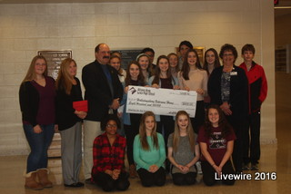 Sharing is caring! The Sharing for the Holidays presents the money donated by AAJHS students to the Veterans