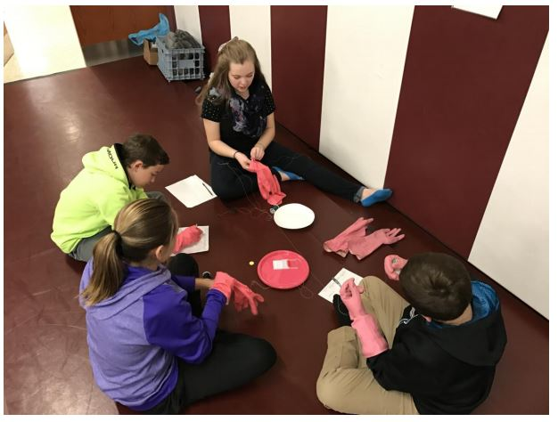 Seventh grade students participate in an alcohol lab to show the motor skills that would not be present while under the influence of alcohol.