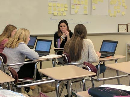 Student teacher Courtney Bauer works with the newspaper students on the topic of resumes.  Students are compiling portfolios to submit to a contest for the Journalism Education Association and Bauer is assisting with that project.