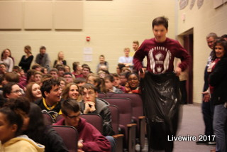 Freshman Ryan Beck hops down the aisle in a garbage bag during the relays. Beck took part in indoor track during the winter season for sports.