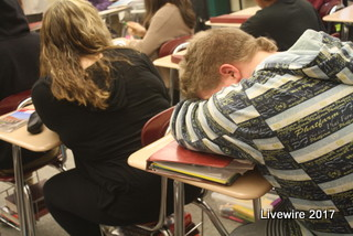 Catching some z's! Students who have trouble getting through the day find relief in taking naps in class. Whenever the opportunity presents it's self many students will take full advantage. Photo by Jolee Smith
