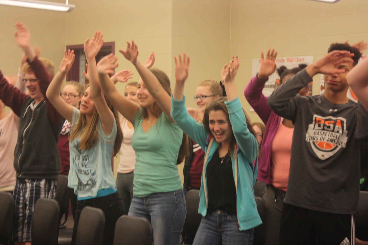 All smiles! The class shares laughter when dancing. The class was excited to perform at their last Jr. High concert.