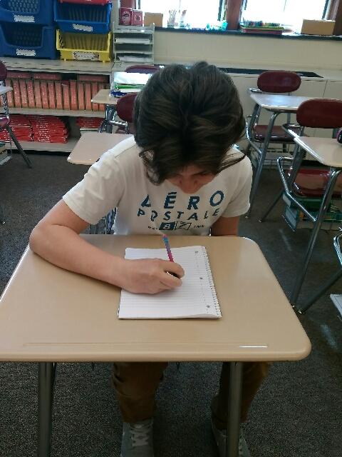Eighth+grader+Skylar+Baughman+designs+Relay+for+Life+t-shirt.+